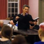 CpM director Jamie Kirsch conducts the chorus during a rehearsal for Les Noces